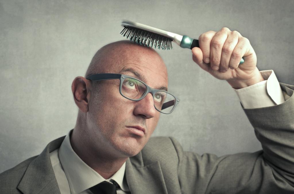 Фото. Любители пощеголять без шапки зимой рискуют остаться без волос